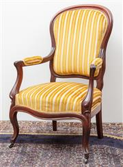 Sale 8940J - Lot 84 - An antique French mahogany bergere C: 1910. The shaped back , arm rest and seat upholstered in 2 tone gold stripes. The serpentine s...