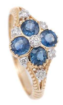 Sale 9140 - Lot 356 - A VICTORIAN STYLE SAPPHIRE AND DIAMOND RING; centring 4 blue round cut sapphires adjacent to 7 round brilliant cut diamonds to chevr...