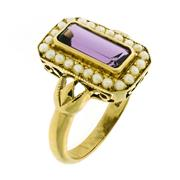 Sale 8253 - Lot 360 - A 9CT GOLD AMETHYST AND PEARL RING; central step cut amethyst to border of seed pearls, size O.