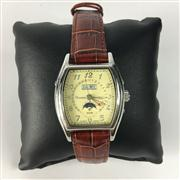 Sale 8283B - Lot 49 - A ROUSSEAU AUTOMATIC WRISTWATCH, with two subsidiary dials with day,month and moon phase aperture on leather band, new in gift box.