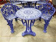 Sale 8792 - Lot 1037 - Victorian Style Cast Iron Garden Setting, comprising a round table and two grape-vine design seats, painted indigo