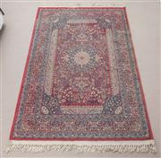 Sale 9070H - Lot 118 - A Persian machine made rug in predominantly crimson and blue tones, 119cm x 178cm
