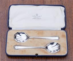 Sale 9190H - Lot 59 - A pair of English hallmarked sterling silver Art Deco serving spoons, Mappin & Webb, Sheffield 1933, Registered design no. 764440, i...