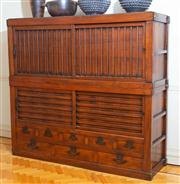 Sale 8630A - Lot 46 - A Japanese elm Tansu chest of impressive proportions, four sliding drawers revealing shelves above eight drawers, separates into two...