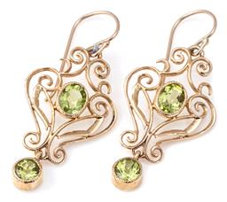 Sale 9124 - Lot 357 - A PAIR 9CT NOUVEAU STYLE GEM SET EARRINGS; each a scrolling frame set with an oval cut peridot suspending a round cut peridot drop,...