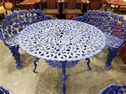 Sale 8792 - Lot 1039 - Victorian Style Cast Iron Garden Setting, comprising a round table and two grape-vine design, two-seated benches, painted indigo