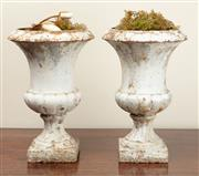 Sale 8917 - Lot 1071 - Two c19th French white painted rustic campagna urns (larger) Height 36cm, Width 36, smaller height 29cm