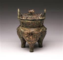 Sale 9110 - Lot 37 - A bronze archaic style lidded censer decorated with Zoomorphic figures and script to legs (H:25cm)