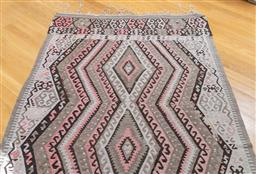 Sale 9165H - Lot 30 - A hand woven geometric woollen rug in greys, browns and dusty pinks, 300cm x 156cm