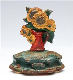 Sale 9164 - Lot 92 - A cast iron daffodil themed door stop (H:12.5cm)