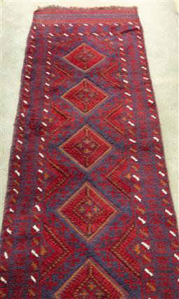 Sale 9190H - Lot 355 - A Persian runner with repeating diamond on blue and red ground, 127cm x 62cm