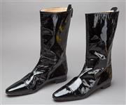 Sale 8541A - Lot 46 - A pair of Manolo Blahnik black patent leather calf length boots with zip to back, good condition, size 37