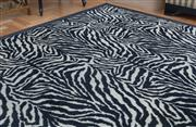 Sale 8562A - Lot 77 - A large contemporary woollen zebra print carpet with black border, 420 x 250cm