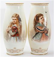 Sale 9083N - Lot 38 - A pair of hand painted and gilt milk glass vases depicting young girls. Signed Ahne. Height 45cm Provenance Christies (sticker to ba...