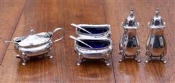Sale 9190H - Lot 193 - An English hallmarked  sterling silver cruet set, Adie Brothers, Birmingham 1948, comprising 2 pepper castors, 2 open salts with mat...