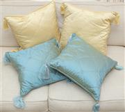 Sale 8402H - Lot 35 - Four tasselled cushions, two yellow, two blue.