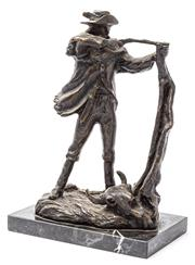 Sale 9083N - Lot 9 - A Bronze figure of a rifleman resting on a tree stump and raised on a marble base. Height 28cm