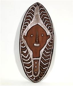 Sale 9142A - Lot 5088 - PNG Gope Board with protruding nose and incised designs, Papuan Golf, PNG: painted with red and white ochre, 92 x 39 cm