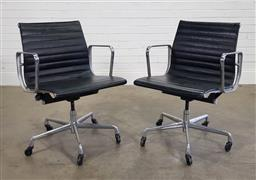Sale 9188 - Lot 1018 - Pair of Eames Aluminium Management chairs with black leather upholstery and on castors  (h:85 w:58 d:47cm)