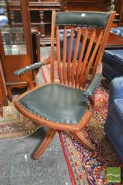 Sale 8282 - Lot 1009 - Late 19th Century Amercian Walnut Desk Chair, with arrow splats & green leather upholstery.