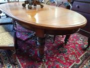 Sale 8792 - Lot 1075 - Late 19th Century Cedar Extension Dining Table, the oval top with two leaves, on winding mechanism, raised on ring turned legs with...