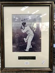 Sale 8805A - Lot 893 - Don Bradman Signed. A photo of Bradman driving at Lords, 1930, signed and framed.