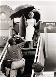 Sale 8755A - Lot 5033 - Eve Arnold (1912 - 2012) - Marilyn Monroe: Arriving at Champaign Airport - Bement, Illinois 1955 43 x 30.5cm (mount size: 72 x 54cm)