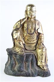 Sale 8849 - Lot 54 - A Cast Gilt Metal Seated Buddha Statue (H 48cm)