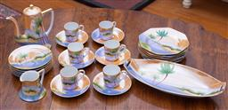 Sale 9190H - Lot 134 - An Art Deco hand painted lustre coffee set for 6 C: 1930's, comprising 6 coffee cups and saucers, 6 biscuit plates, 6 cake plates, c..