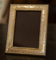 Sale 7981B - Lot 41 - A Sterling Silver photo frame with hammertone finish; 140mm x 180mm