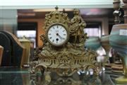 Sale 8189 - Lot 64 - Metal Figural Mantle Clock with a Key