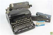 Sale 8608 - Lot 47 - Black Remington Typewriter with Additional Ribbons
