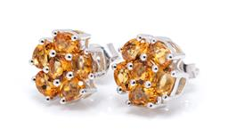 Sale 9253J - Lot 416 - A PAIR OF SILVER CITRINE CLUSTER STUD EARRINGS; each centring a round cut citrine to surround set with 5 oval cut citrines, size 9.5...