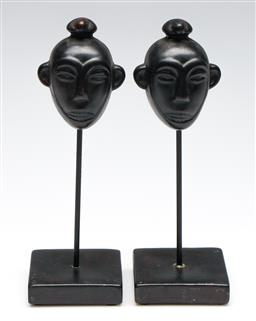 Sale 9253 - Lot 397 - Composite pottery African ebonised masks on stands (2) (H:23cm)