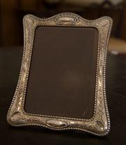 Sale 7981B - Lot 47 - A large Sterling Silver photo frame with floral garland decoration; 190mm x 240mm