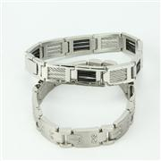 Sale 8257B - Lot 72 - A TITANIUM & A STAINLESS STEEL/LEATHER BRACELET; new in boxes.