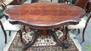 Sale 8375 - Lot 1062 - Victorian Rosewood Shield-Shaped Table, with carved pedestal base