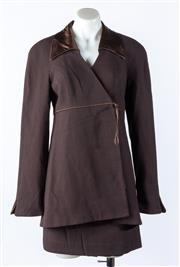 Sale 9003F - Lot 35 - A Bayou suit in brown silk, comprising a skirt and tie up collared blazer Size 8.