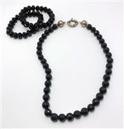 Sale 9031H - Lot 90 - Onyx Necklace with Sterling Silver large boltring Clasp, L48cm and two matching bracelets on elastic -