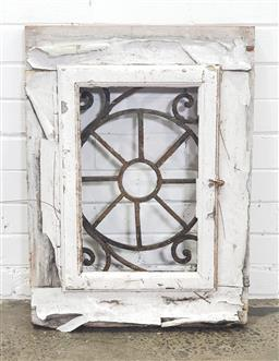 Sale 9151 - Lot 1482 - Rustic outdoor window with wrought iron wheel to centre - 203 (h74 x w53 x 5cm)