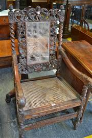 Sale 8093 - Lot 1765 - 17th Centuery Style Carved Oak Armchair w Barley Twist Supports and Caned Back & Seat (cane AF)