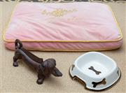 Sale 8562A - Lot 141 - A daschund form boot scraper, together with a ceramic dog bowl, and a Langham Hotel, Sydney, pink velvet pillow