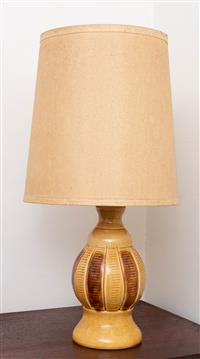 Sale 8735 - Lot 8 - A retro pottery lamp in mustard with incised decoration Height 57cm with shade, together with smaller example 26.5cm