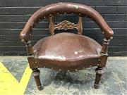 Sale 8993 - Lot 1044 - Late Victorian Carved Walnut Desk Armchair, upholstered possibly in brown leather, with scroll back rail & turned carved legs (H: 76cm)
