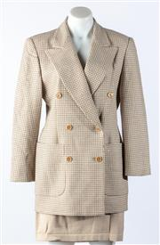 Sale 9003F - Lot 6 - An Escada double breasted jacket with front pockets in Beige check together with a beige skirt, size 40