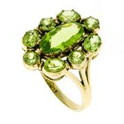 Sale 8253 - Lot 346 - A VICTORIAN STYLE PERIDOT CLUSTER RING; central oval peridot surrounded by 4 round and four oval peridots in 9ct gold, size N-O.