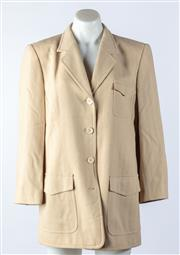 Sale 9003F - Lot 12 - An Escada Safari Jacket in beige with front pockets, size 40
