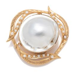Sale 9099 - Lot 139 - A large round blister pearl brooch within a leaf border set with twenty-one [21] small pearls in 14ct yellow gold. Weight: 26.3 gr...