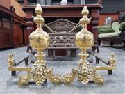 Sale 8792 - Lot 1005 - Pair of 19th Century French Brass Fire Dogs, with turned posts & cherubs heads below
