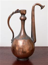 Sale 8735 - Lot 9 - A middle eastern copper tea ewer with elevated spout, total height 33cm